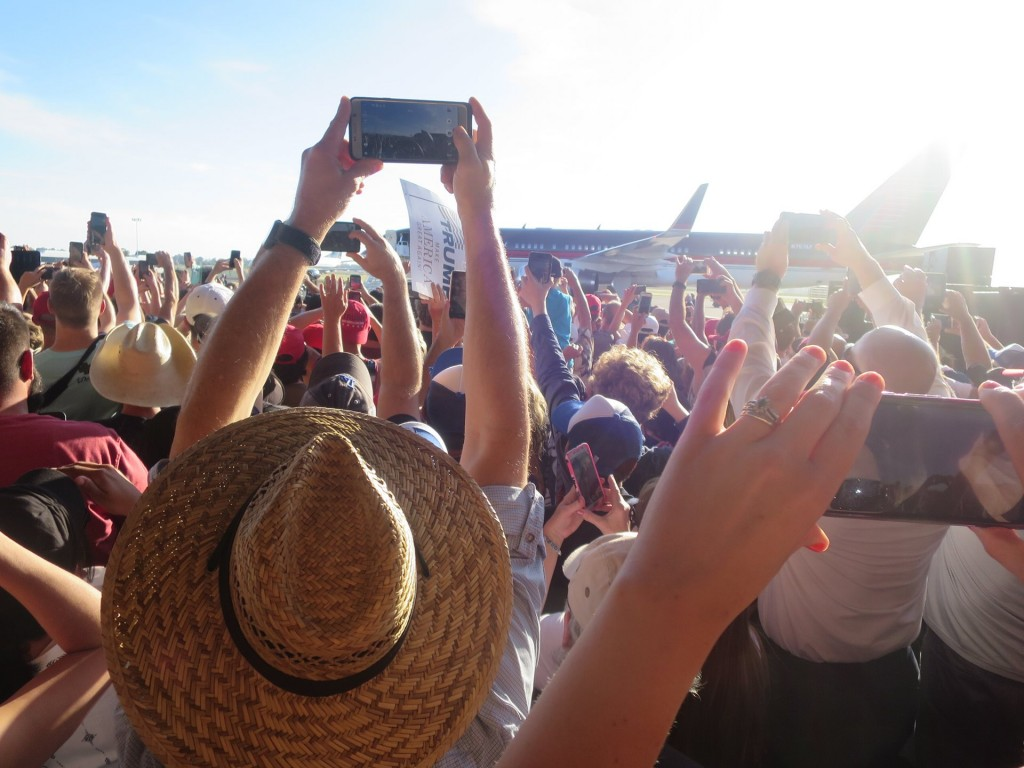 Caption: The crowd greets Trump's plane Photograph: Dave Eggers image source: https://www.theguardian.com/books/2016/jun/17/could-he-actually-win-dave-eggers-donald-trump-rally-presidential-campaign