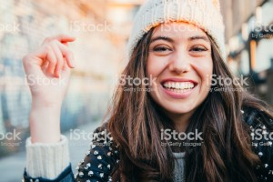Woman smiling with whool hat, iStock